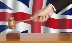 Veľká Británia žaluje daň zfinančných transakcií na súde
